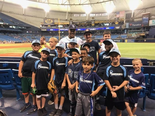 Rays outfielder and Tallahassee product Mallex Smith with Tallahassee players before the Rays game last Saturday at Tropicana Field.