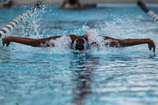 Chiles' Ryland Sun swims butterfly during a recent swim meet.