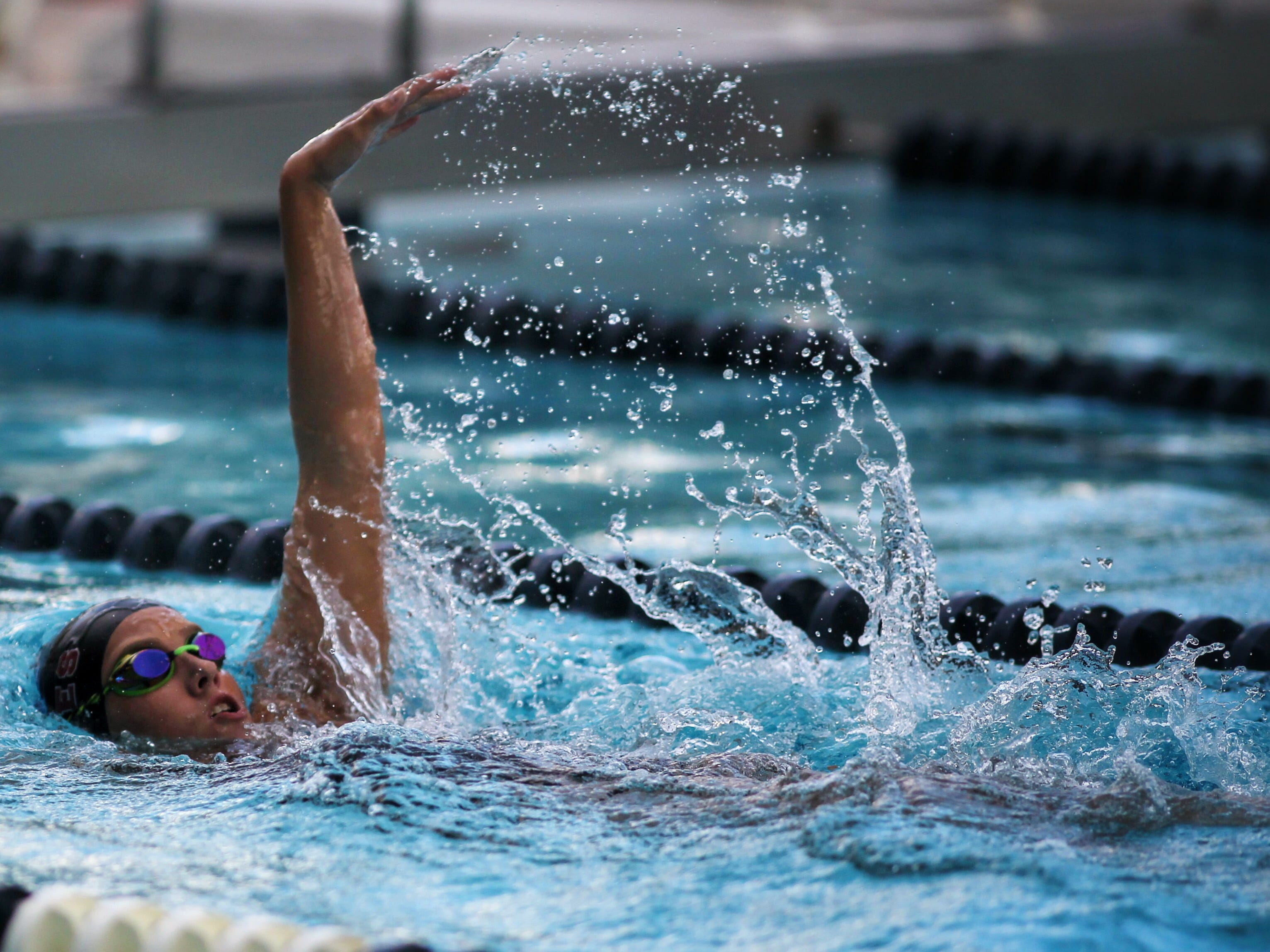 Chiles' Stella Grace Watts swims backstroke in the 200 IM during a recent swim meet.
