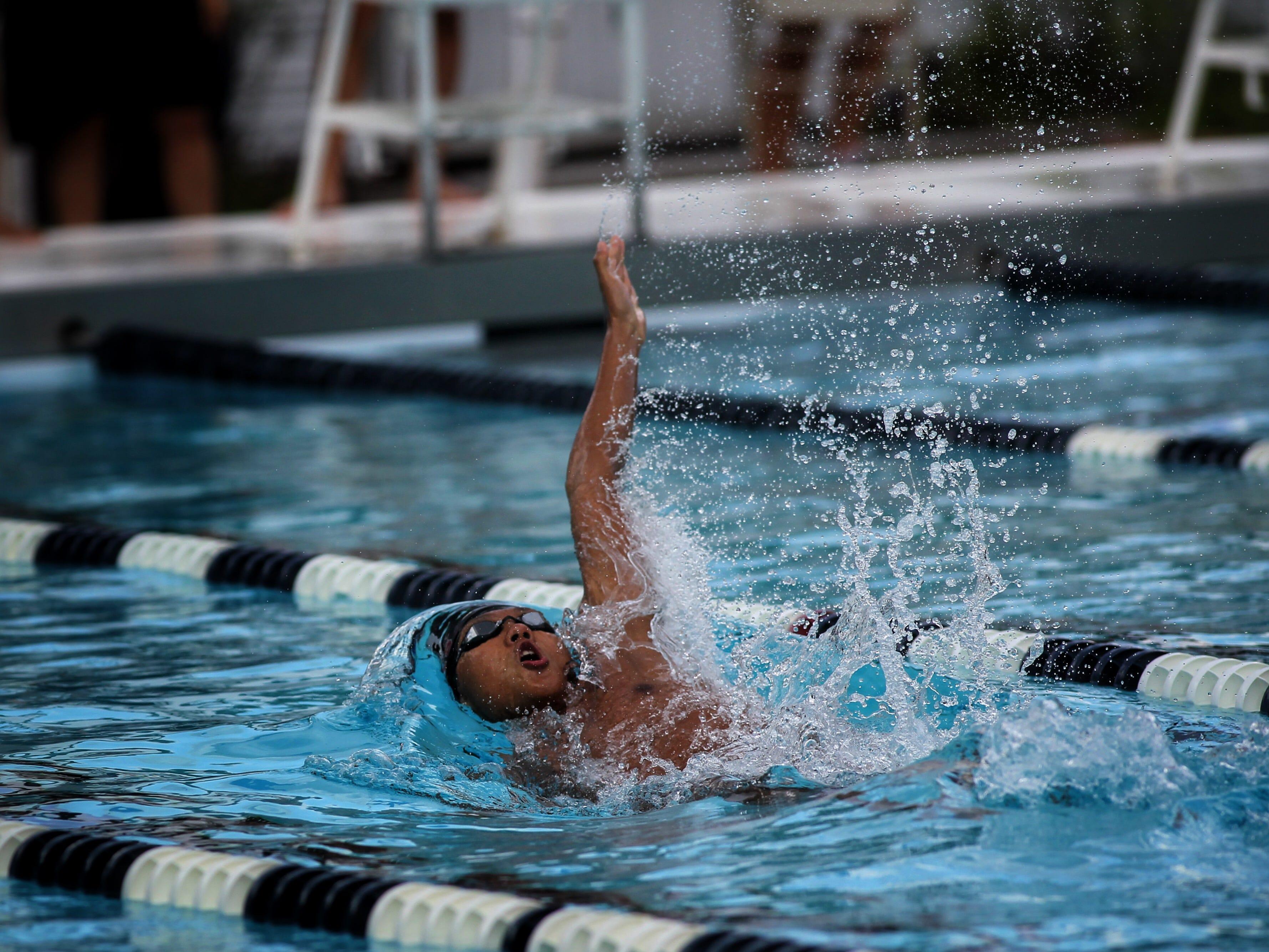 Chiles' Hayden Kwan swims backstroke during a recent swim meet.