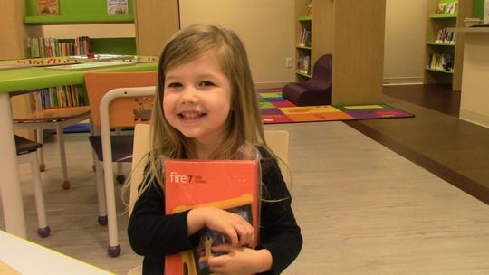 Delayni Ellis, 4, was the Read to Me (3-5) winner at the Lewis Branch Library.