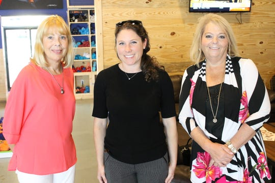 Karen Bailey, left, Taylor Hoskins and Joan Freeman at Sailfish Brewing Co. for the United Way of St. Lucie County's Women United Recruitment Event on Sept.13.