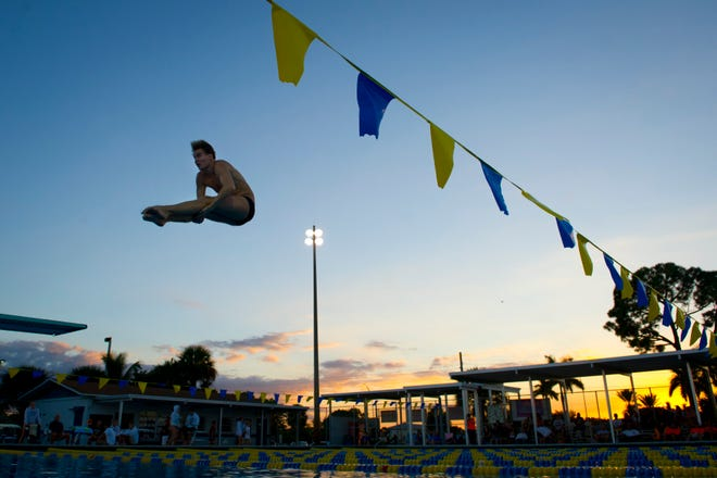 Lincoln Park Academy senior Demetri Demet performs a dive in 2013 during a competition against Martin County High School at the Martin County High School pool in Stuart.