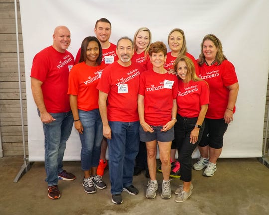 The Wells Fargo team was one of 20 teams of corporate volunteers who participated in United Way of Martin County's Day of Caring and Sept. 11 Remembrance Ceremony.