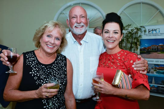 Corine Barr, left, Walker Schamback and Rachel Cloutier support the HANDS Clinic of St. Lucie County by attending the Jewelia Project's Sizzling Havana Night at Pelican Yacht Club in Fort Pierce.