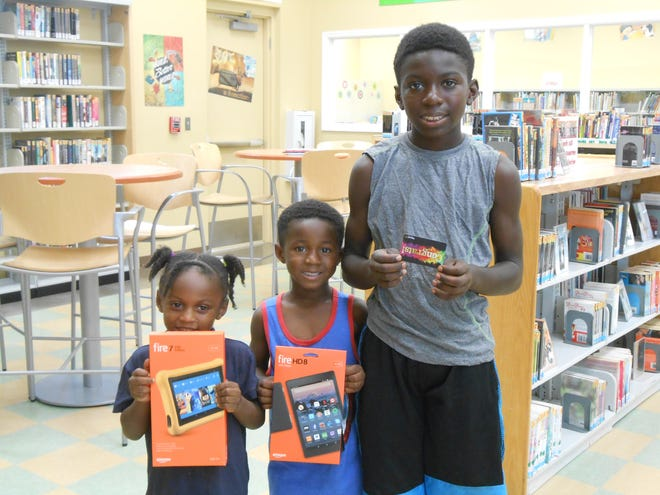 This trio of siblings won the reading challenge at the Zora Neale Hurston Branch Library: Read to Me (3-5): Lu'Anna Williams, 4; K-5th Grade: Inesh Williams, 5; and Teens: Lugene Williams, 12.