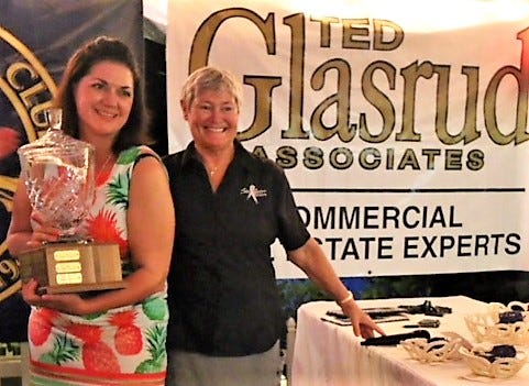 Jennifer Cameron of Stuart, left, received the Polly Whippen Memorial Trophy as the top lady angler in the Stuart Sailfish Club's Saltwater Sisters annual fishing tournament Saturday. She and husband Capt. Glenn Cameron own Floridian fishing charters at Sailfish Marina.