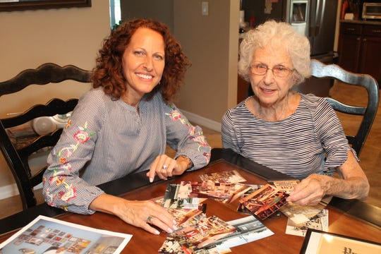 Janet Olsson and Marie Ferretti going through old photos from Hoppe's.