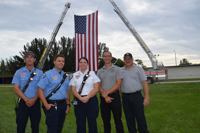 First responders participated in United Way of Martin County's Day of Caring and Sept. 11 Remembrance Ceremony. Left to right: Dillon Hataway, Jason Keane and Priscilla McGill, Martin County Fire Recue; Sean Eichling and and Donald Lesko, City of Stuart Fire Rescue.