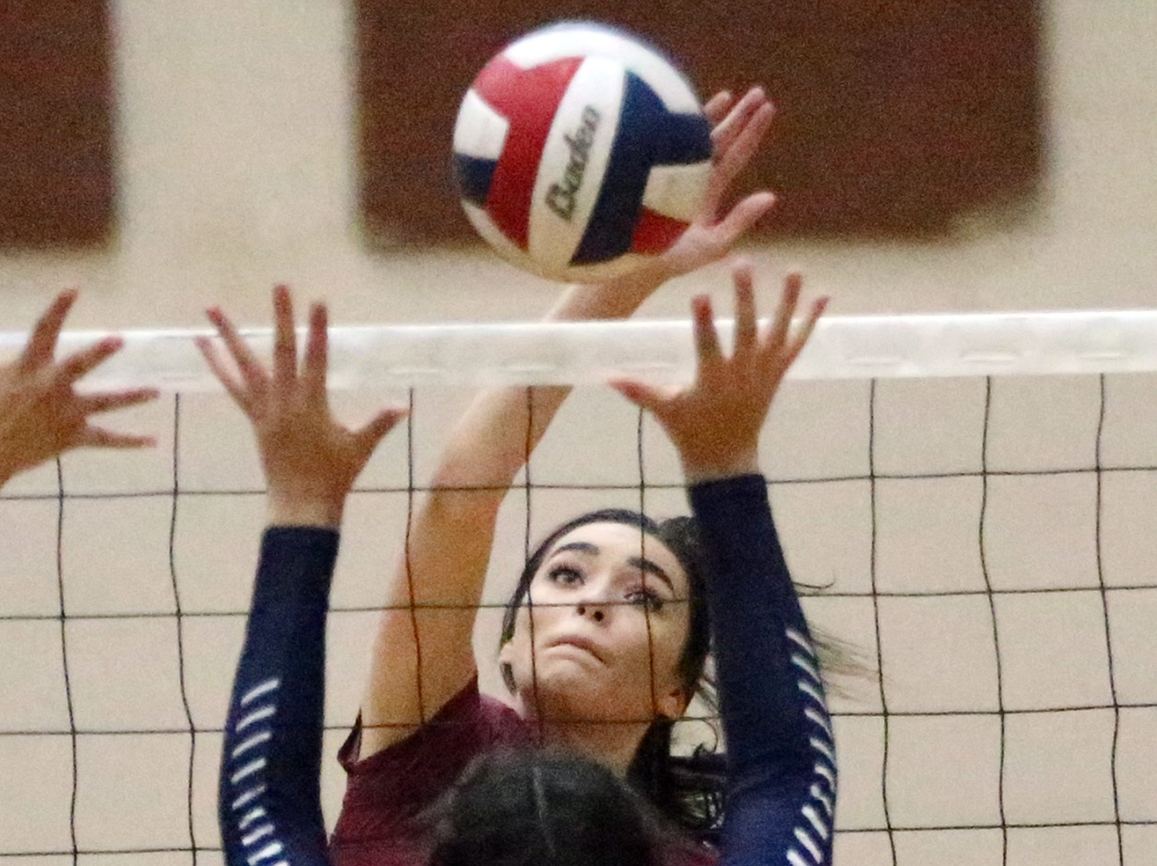 Paige McGriff, 1, of El Dorado fires over the net at Del Valle. She helped lead El Dorado to the District 2-5A title.