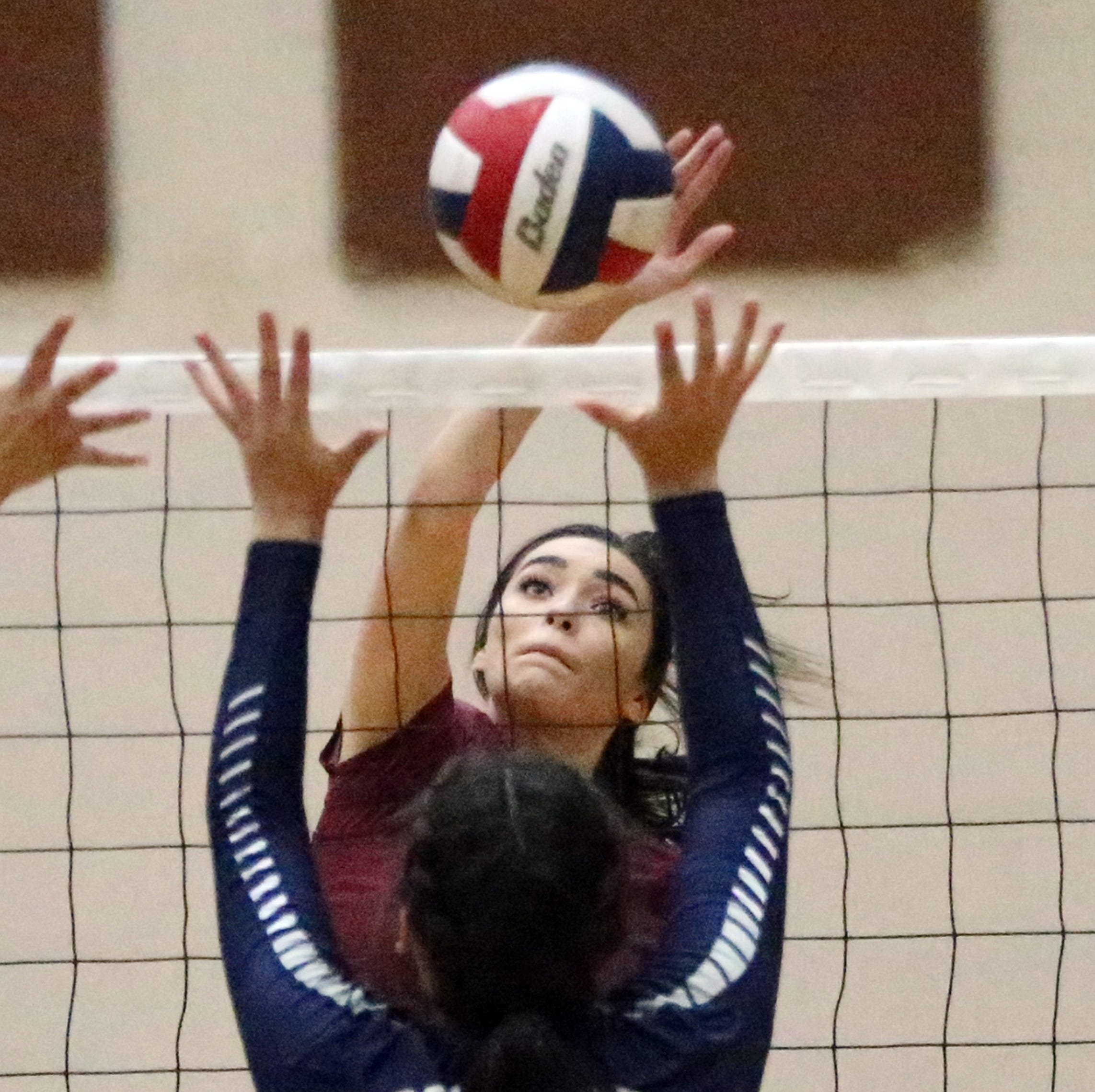 Paig Mcgriff, 1, of El Dorado fires over the net at Del Valle Tuesday night at Del Valle. El Dorado won the contest in three sets.