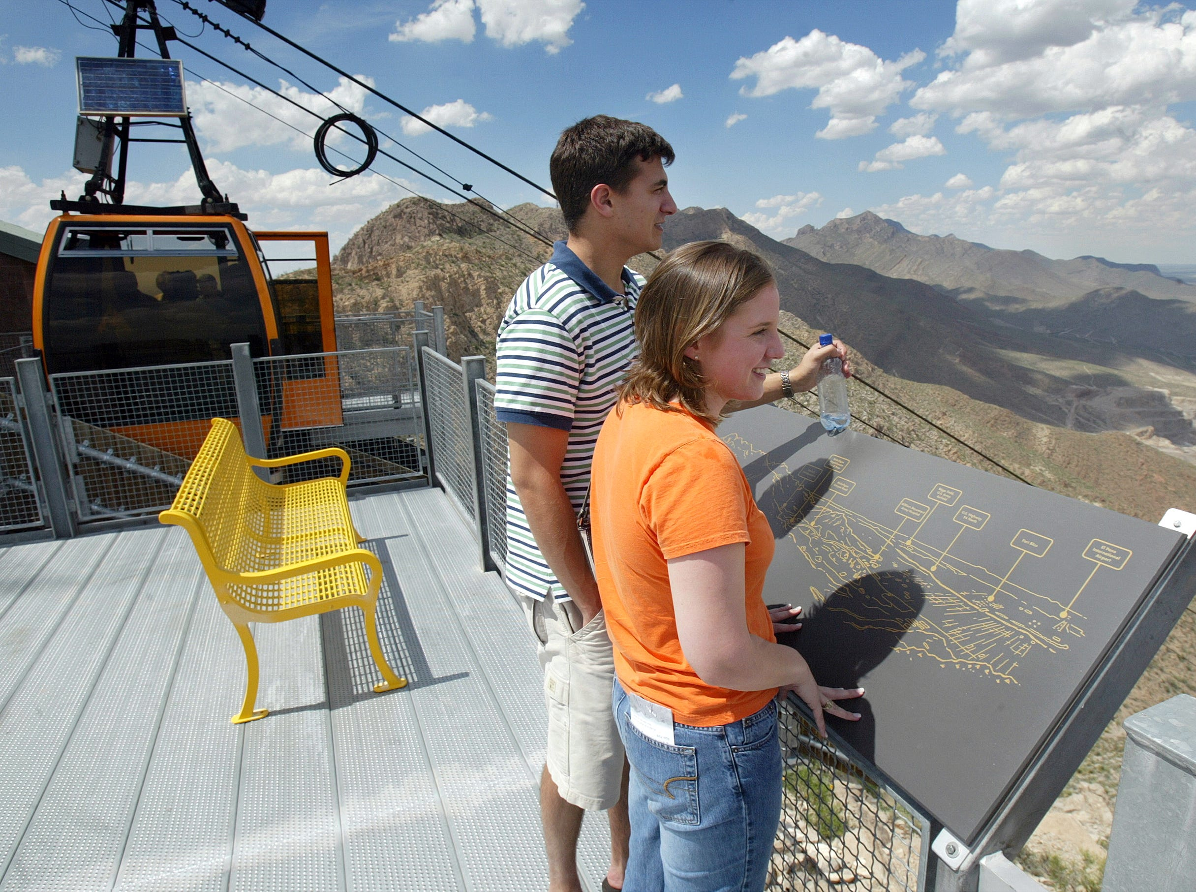 Brette Peyton and David Alexander look out over El Paso atop Ranger Peak via the Wyler Aerial Tramway.