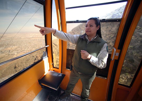 Diana Moy, park interpreter at the Wyler Aerial Tramway, points out features while riding the cable car down from the scenic area atop the Franklin Mountains.