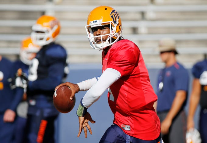 UTEP quarterback Kai Locksley looks over at his receiver during passing drills Wednesday in Sun Bowl Stadium. The Miners continue their preparations for their game Saturday afternoon against the NMSU Aggies in the Sun Bowl.