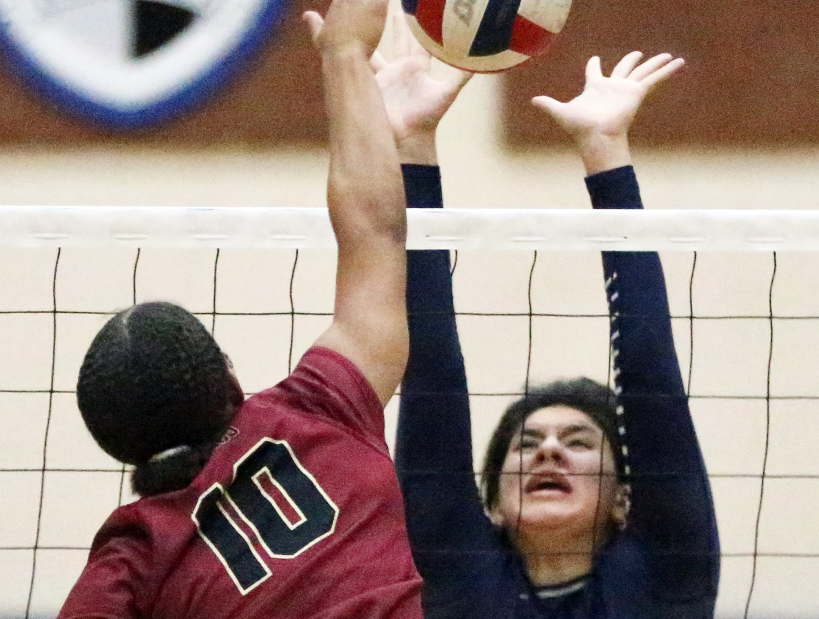 Madison Valverde, 12, of Del Valle rises in a futile effort to block a shot by Darling Harris, 10, of El Dorado Tuesday night at Del Valle. The Aztecs beat the Conquistadores in three sets.