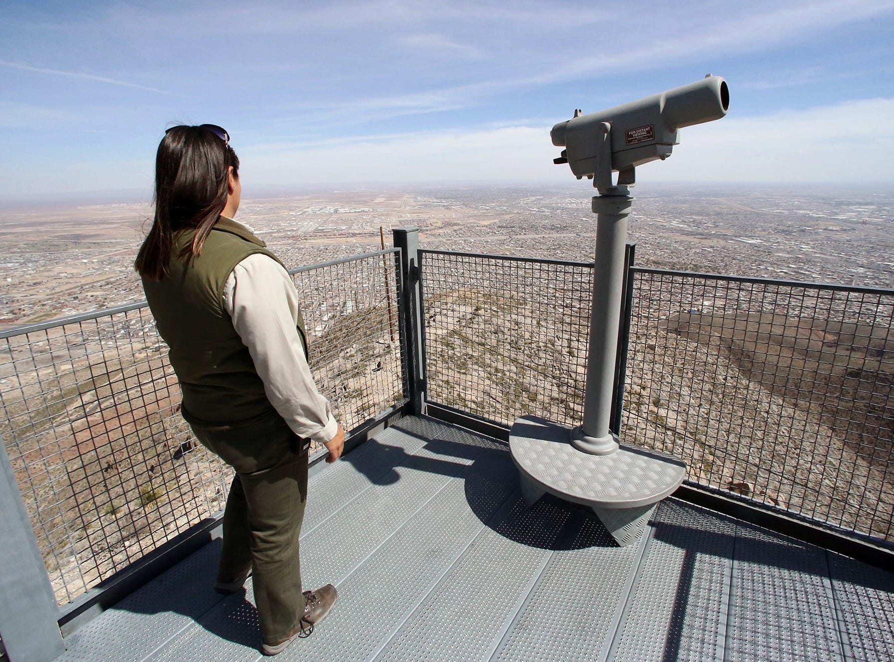 Park interpreter Diana Moy takes in the view at the Wyler Aerial Tramway scenic overlook atop the Franklin Mountains. Currently, most of the park?s visitors are from out of town, but park officials hope to attract more local residents. The tramway will celebrate its 17th anniversary as a state park Saturday.