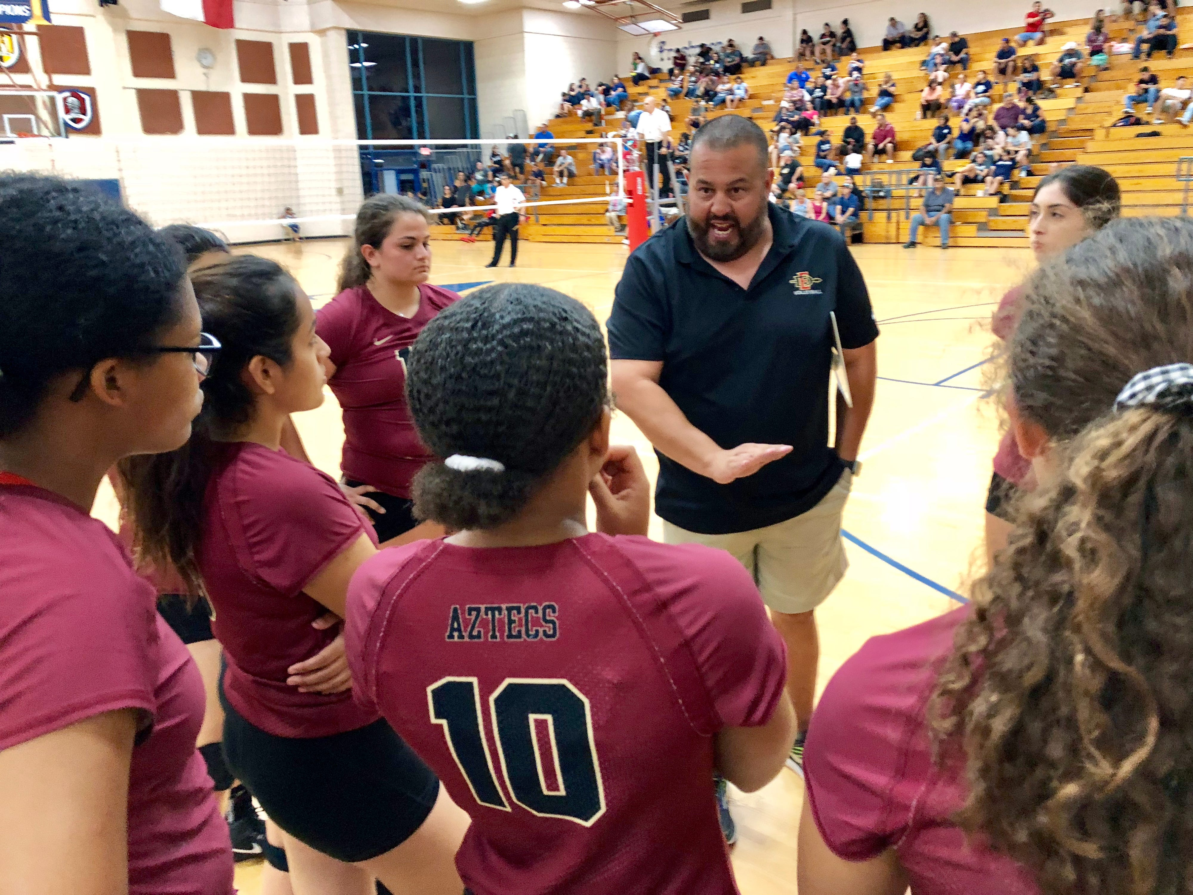 El Dorado coach Roel De Anda fires up his team after they won a close first set against Del Valle on Tuesday night at Del Valle. El Dorado went on to win the match in three sets.