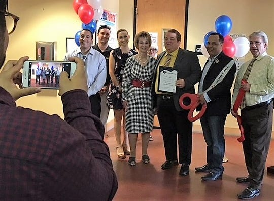 Joyce Wilson, CEO of Workforce Solutions Borderplex, Mark Pumphrey, the city's libraries director, center, and other officials celebrate the Sept. 12 ribbon-cutting for the employment agency's new employment office in the Downtown Main Library.