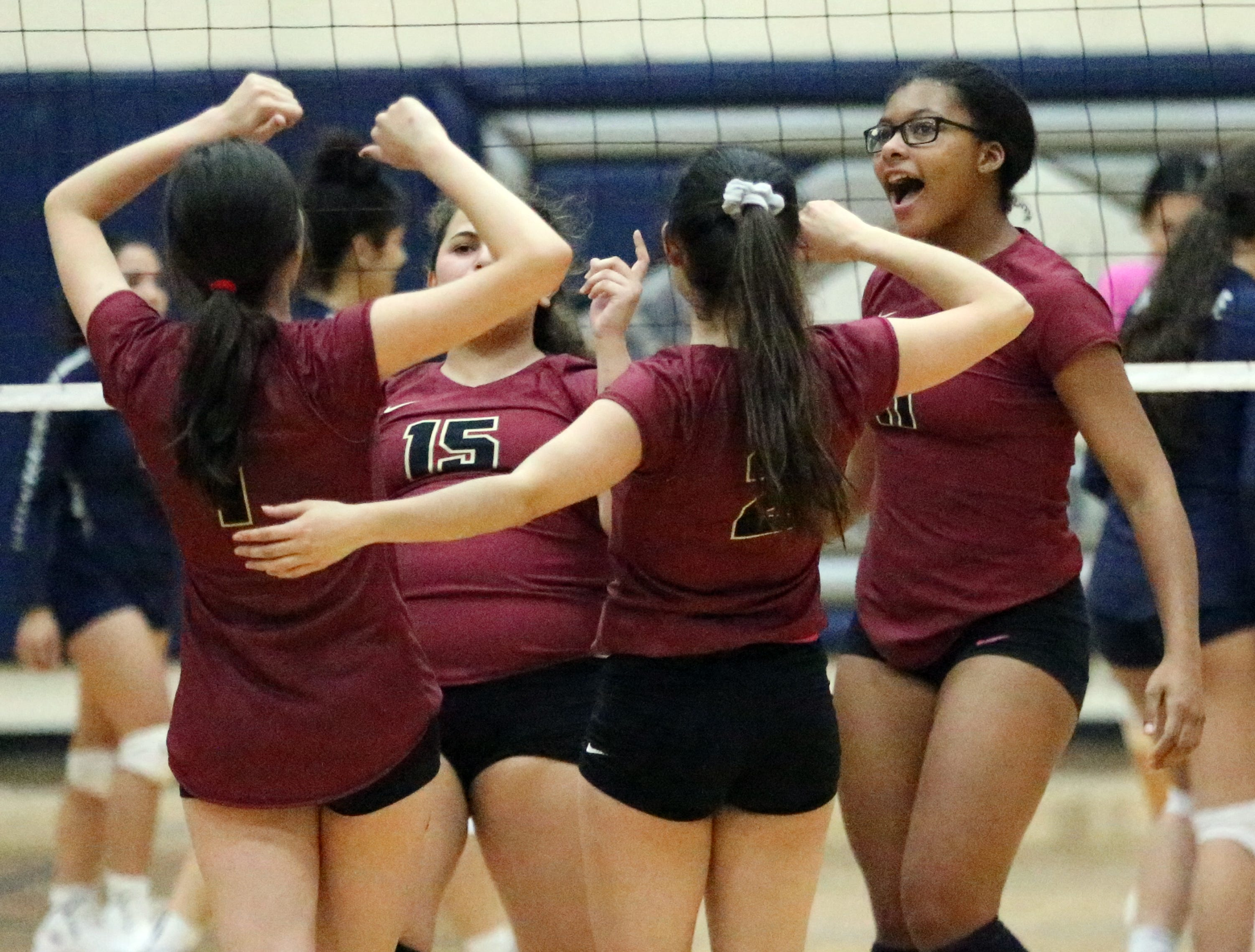 El Dorado players celebrate a point against De Valle on Tuesday night.