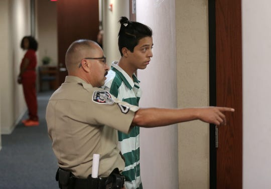 Julian Saucedo appears before Judge Robert S. Anchondo in County Criminal Court No. 2 for a hearing on his interfering with an officer charge. Saucedo originally was released on bond but was ordered jailed by Anchondo when he was three hours late to his initial hearing. Saucedo is the 17-year-old who was arrested in a viral video that showed an El Paso police officer pulling his gun on a group of children.
