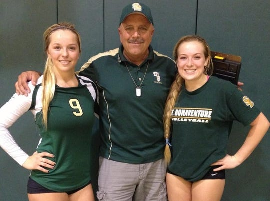 "Jack Richards, center, poses with players Kirra Drury and Sydney Morris when he was their coach at St. Bonaventure High. Drury died Sept. 1 in a boating accident. ""(Kirra) was one of those players who never left the court,"" said Richards. ""She was so important in so many areas. What really impressed me most was her hard work."""