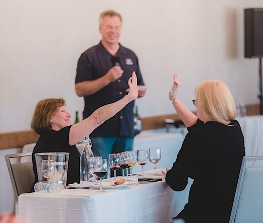Ventura County-based sommeliers Lisa Stoll, left, and Kristen Shubert celebrate their first-place win at the U.S. Open Wine Tasting Competition in Marina del Rey in August. Their score earned them a place on Team USA for the World Wine Tasting Championship next month in France.