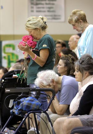Denise Olson Drury clutches her bouquet of roses, given to her by the St. Bonaventure High girls volleyball team, during a moment of silence honoring her daughter Kirra before a match against Foothill Tech on Tuesday night. Kirra Dury, who starred at St. Bonaventure, died in a boating accident on Sept. 1.