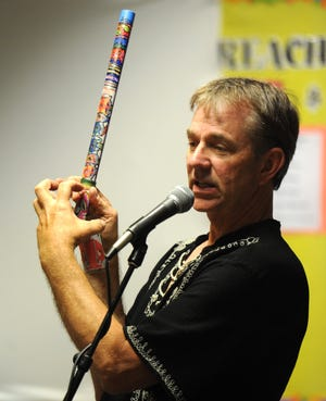 John Zeretzke shows a finished flute as he speaks to a group of people that were in attendance for a Ventura fundraiser for Flutes Across the World in 2012.