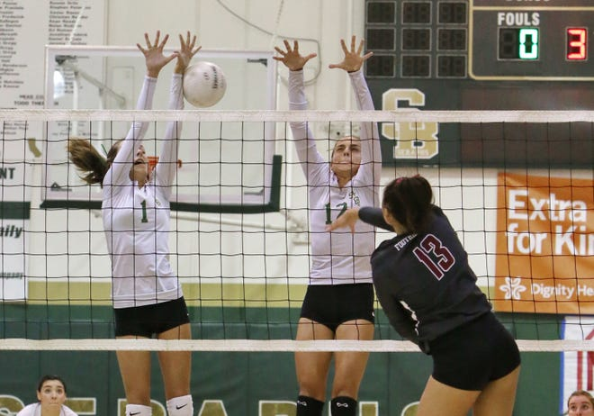 St. Bonaventure High's Tyler Behrens, left, and Chloe Decas go up for the block against Foothill Tech's Haley Higgins  during Tuesday's Tri-Valley League match. Foothill Tech won in five games.