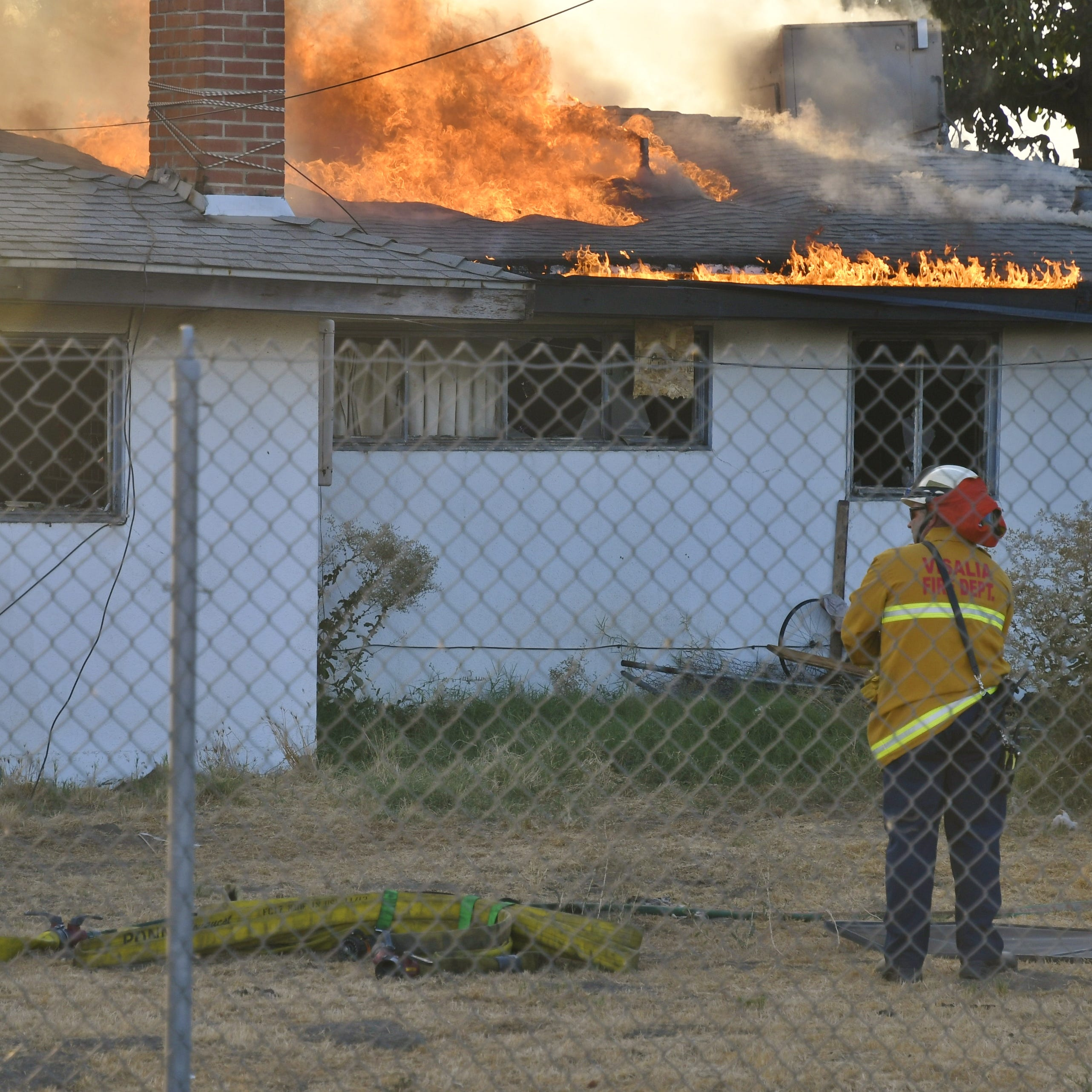 'Trouble' home goes up in flames, Visalia firefighters let it burn
