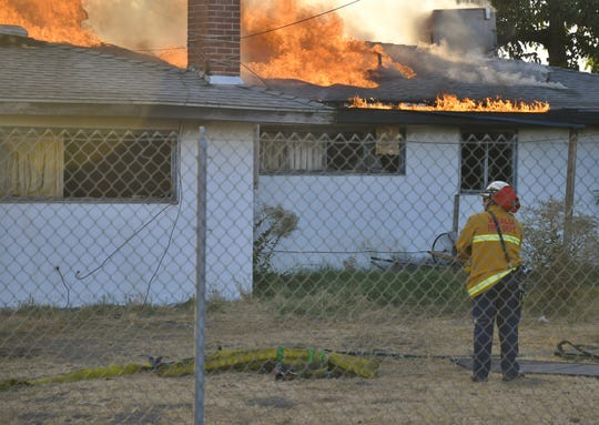 Firefighters are letting a home in north Visalia burn because of unsafe conditions.