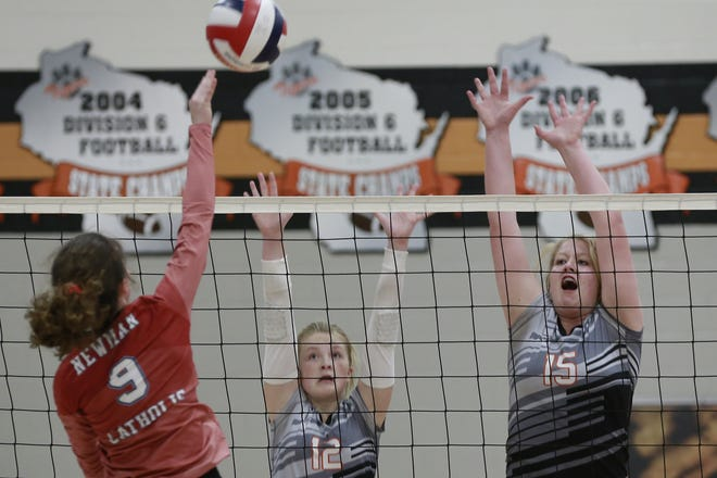 Stratford's Lauryn Nagel , right,  and Brooke Peterson go up to try and block a hit from Newman Catholic's  Elise Johnson during a Marawood Conference South Division volleyball game at Stratford.