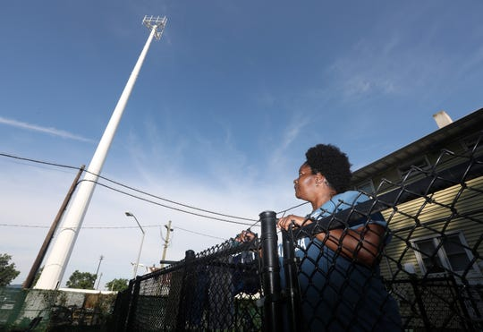 A newly constructed cell tower by the MTA looms over concerned resident Tammy Thompson's home at the Franklin Courts  low-income housing complex in Tarrytown Sept. 19, 2018. The MTA, which is exempt from local zoning, put up a cell tower right next to the Franklin Courts complex and playground, and residents are concerned for their safety.