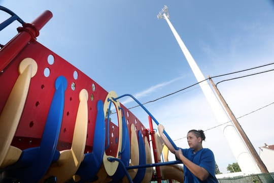 Tanyon Gerena, 12, is photographed at the the Franklin Courts low-income housing complex's playground Sept. 19, 2018 in Tarrytown. The MTA, which is exempt from local zoning, put up a cell tower right next to the Franklin Courts complex and playground, and residents are concerned for their safety.