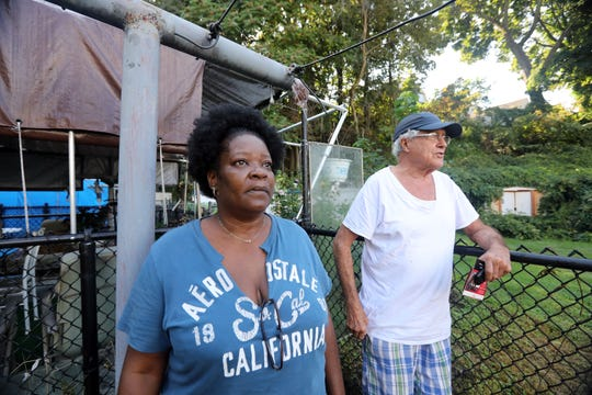 Residents Tammy Thompson and Christopher Ledema say they are concerned for their safety with the newly constructed cell tower beside their homes at the Franklin Courts low-income housing complex in Tarrytown Sept. 19, 2018. The MTA, which is exempt from local zoning, put up a cell tower right next to the Franklin Courts complex and playground, and residents are concerned for their safety.