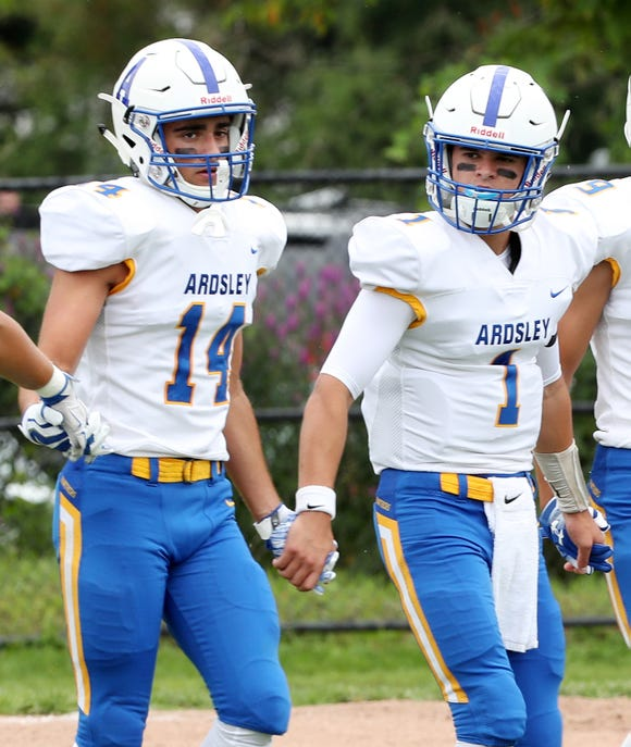 From left, Ardsley's Vinny Manzi and Frank Belarge walk onto the field prior to the start of the season opener against Pleasantville at Parkway Field in Pleasantville Sept. 2, 2018. Ardsley went on to defeat the reigning state champions 34-6.