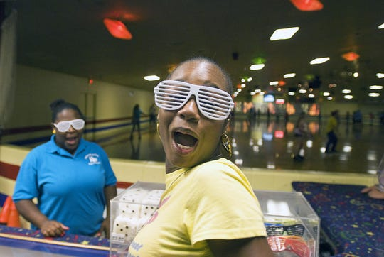 Aparsha Allen, 16, of Newark, has fun with her friends at Christiana Skating Center in Newark on a Saturday night in 2008.  In the wake of Christiana Mall's decision not to allow teens on Friday and Saturday nights without a parent, teens had to find alternative ways to keep themselves occupied.