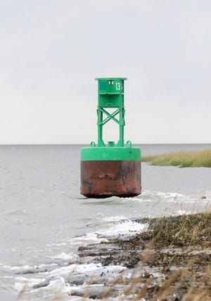 A buoy washed ashore on Woodland Beach last week is believed to have broken loose during high tides and high winds associated with Hurricane Florence.