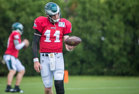 Quarterback Carson Wentz runs practice drills at the NovaCare Complex in Philadelphia. Wentz prepares to take the field for the first time in the 2018 season this Sunday against the Indianapolis Colts.