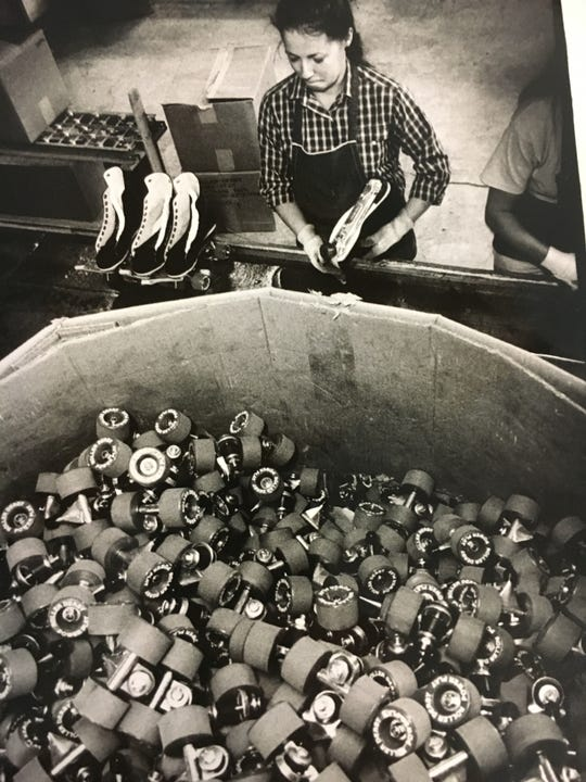 Barbara Knott finishes assembly of some high-end roller skates at Roller Derby Skate Corp in 1984.