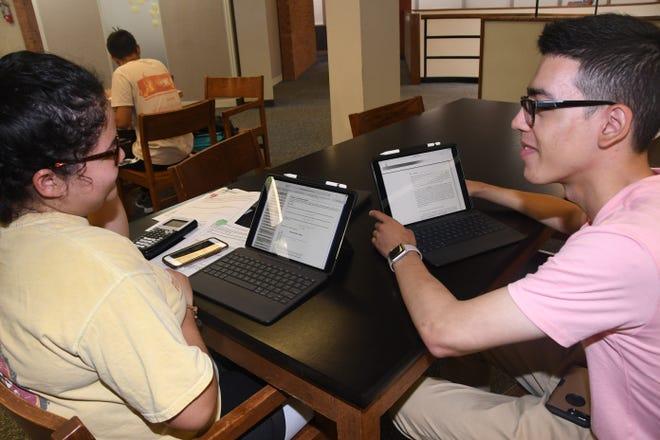 Freshmen Karine Hernandez and Filiberto Camarillo study in the Delaware State University library with their new iPad Pros.