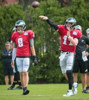 Quarterback Carson Wentz run through warm up exercises as the Eagles practice at the NovaCare Complex in Philadelphia. Wentz prepares to take the field for the first time in the 2018 season this Sunday against the Indianapolis Colts.
