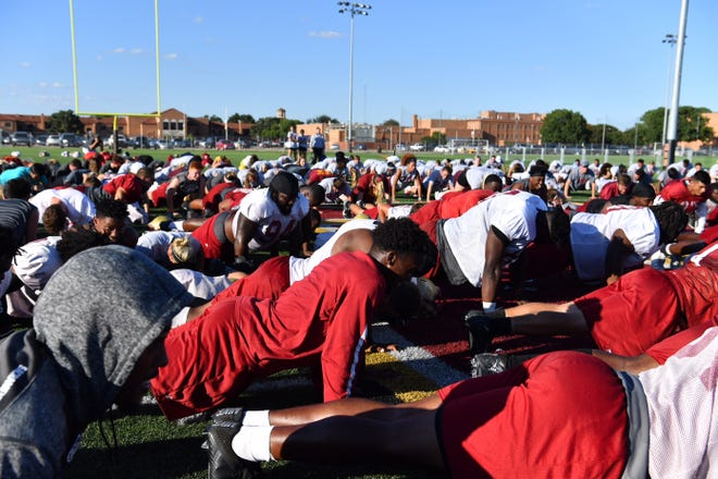 MSU Texas football players, other campus organizations and athletes do 24 push-ups Wednesday afternoon in remembrance of their teammate Robert Grays, jersey number 24, on the one-year anniversary of his death. Grays died after being injured during an MSU home football game in 2017.