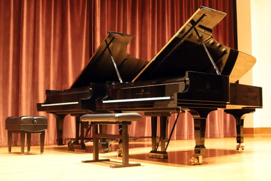 Two pianos are seen on a stage at MSU Texas. The university is celebrating a large donation of pianos with an open house and concert Sept. 28.