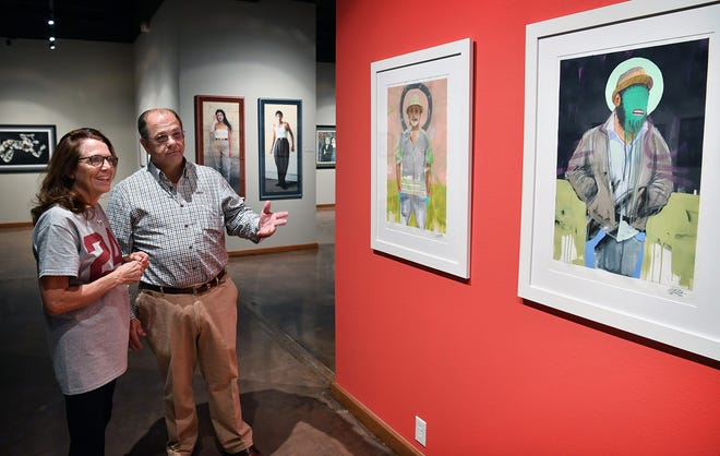 Mary Helen Maskill and Bryant Medders talk about the exhibit of Chicano art from the collection of Cheech Marin on display at the Wichita Falls Museum of Art at Midwestern State University. Betsy and Bryant Medders sponsored the exhibition.