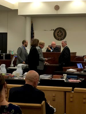Prosecuting and defense attorneys have an off-the-record bench conference with 30th District Judge Bob Brotherton in a Fort Worth courtroom.