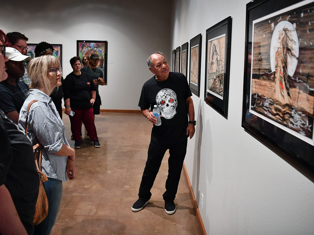 Cheech Marin speaks to a group of Midwestern State University art students Wednesday about some of the pieces in his art collection on display at the Wichita Falls Museum of Art at MSU. Marin is one of the preeminent collectors of Chicano art in the world.