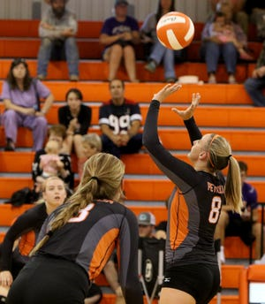 Petrolia's Maxine Nason sets the ball up in the game against Windthorst Tuesday, Sept. 18, 2018, in Petrolia.