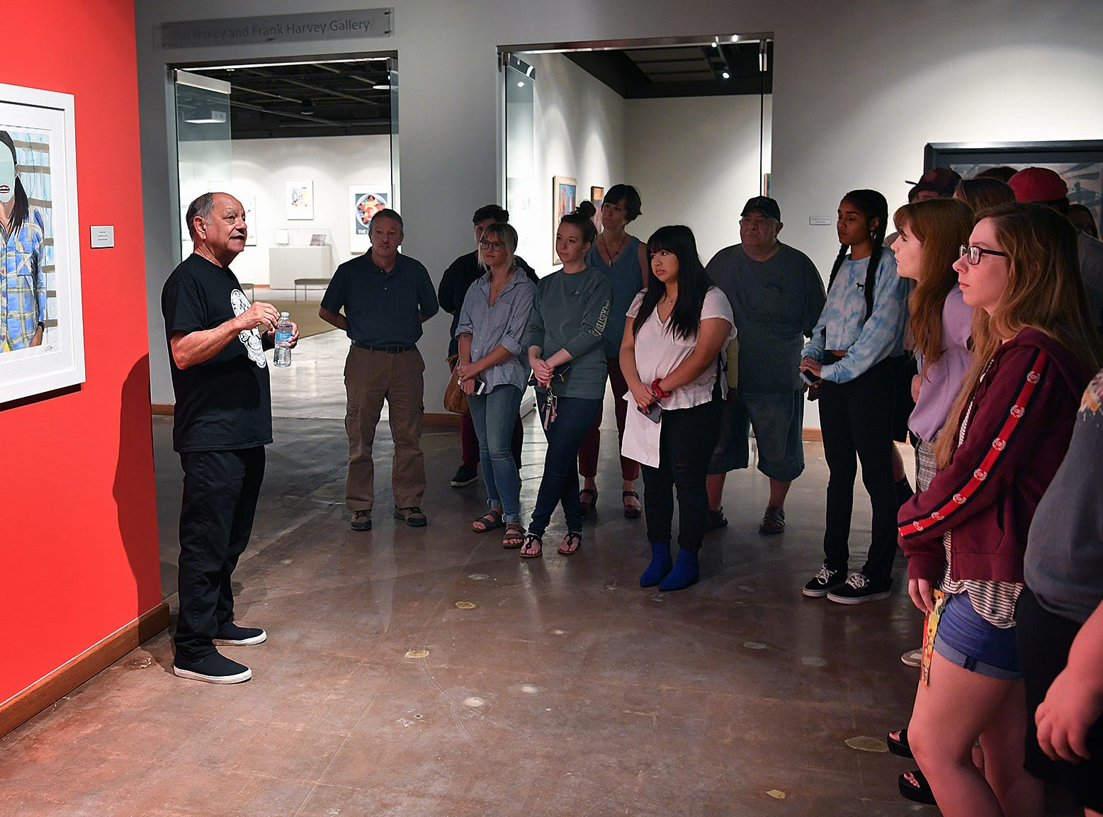 Midwestern State University art students listen as Cheech Marin talks about the exhibit of Chicano art from his collection at the Wichita Falls Museum of Art at MSU Wednesday morning.