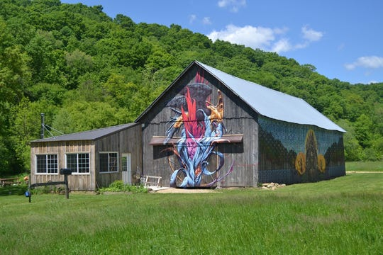 A venerable tobacco barn, seen here before the flood that destroyed it, was painted by a noted artist and was used for gatherings of  up to 4,000 people each fall who came for wagon rides, pumpkin harvest and cookouts. The summer kitchen and wood-fired pizza oven were lost in the flood along with tractors and wagons.